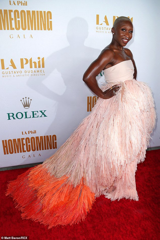 Glamour girl:Cynthia Erivo was the obviously belle of the ball as she walked the carpet in a quirky pink gown with a fringe skirt that showed off legs