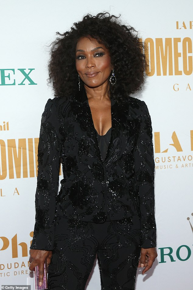 Ageless:Bassett radiated youth as she rocked a figure-hugging black pantsuit embellished with black sequin appliques