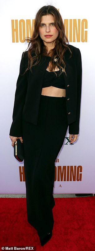Cool factor: Lake Bell flashed her toned midriff in a black bralette top layered beneath a loose fitting blazer