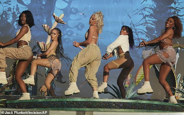 Matching: On her feet the Kiss Me More singer rocked white platform boots, also worn by each of her backup dancers
