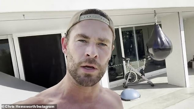Dusting off the weights: Chris Hemsworth, 38, (pictured) performed a brutal workout on Sunday after admitting he needed a lift after 'a few too many celebratory drinks over the weekend'