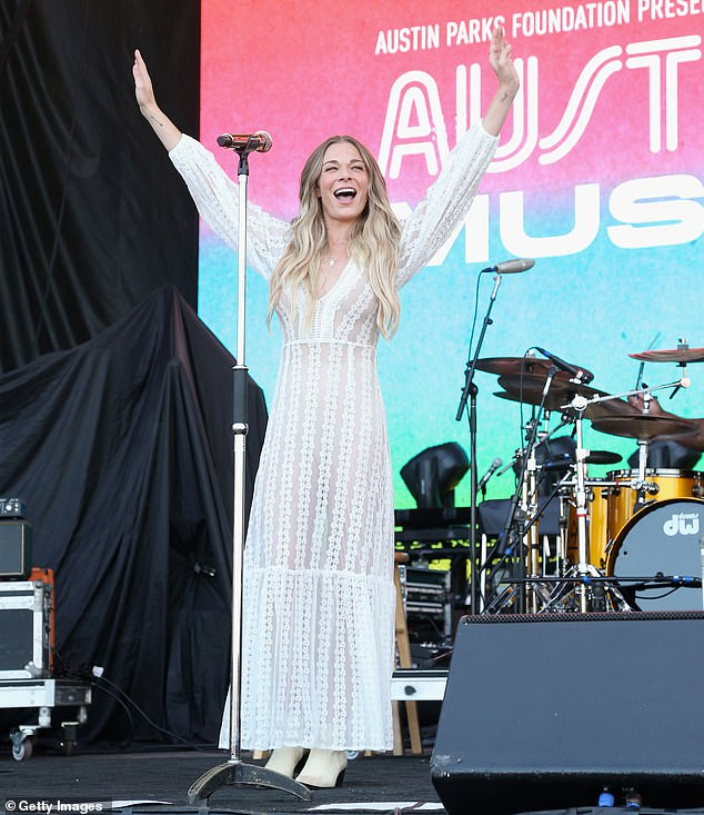 Welcoming:LeAnn Rimes stunned in a floor-length boho dress and white cowboy boots while greeting ACL Fest attendees with a friendly wave