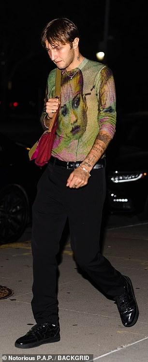 Stylin': Anwar stepped out on to the street in black pants with a multi-colored shirt and black shoes