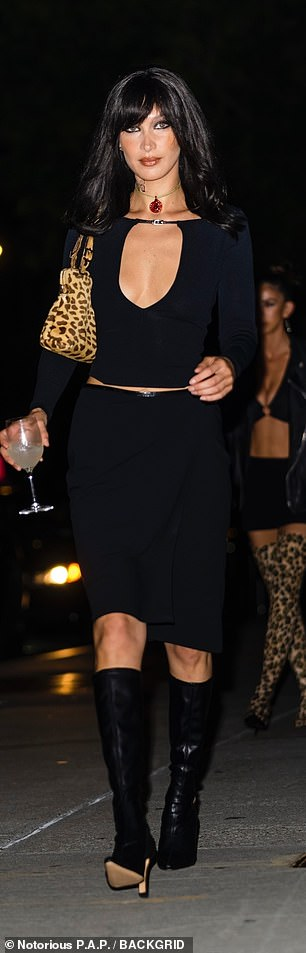 Sexy number: The birthday girl also wore a knee-high skirt with the cop top
