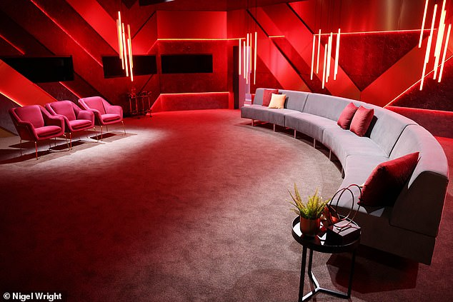 Where the eliminations go down! The elimination area features a grey curved sofa and three plush red velvet chairs