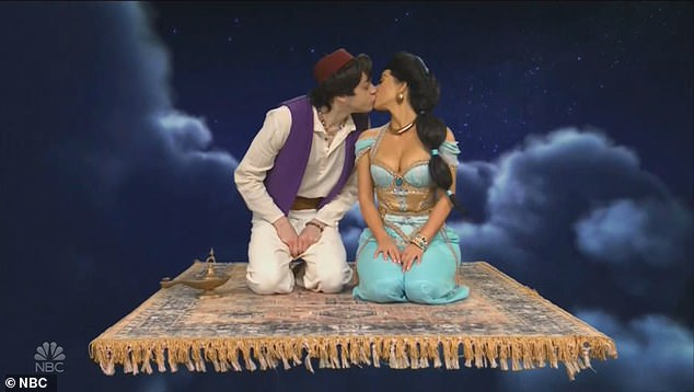 Locking lips: Kim and Pete Davidson shared a kiss as they acted in a sketch portraying Aladdin and Princess Jasmine