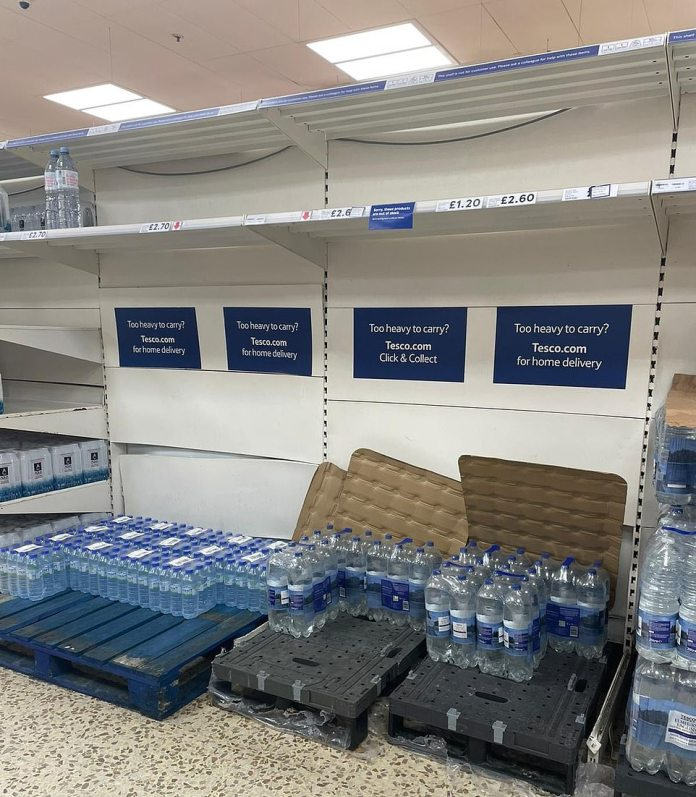 Partially empty shelves at a Sainsburys supermarket in London Colney, Hertfordshire