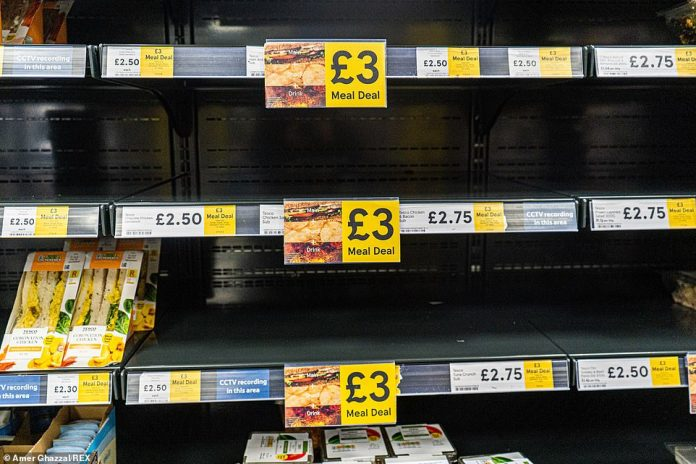 Half empty shelves of ready meals at a Tesco branch in Wimbledon today