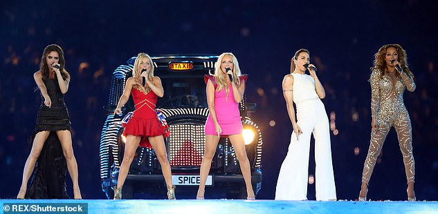 Five-piece:Victoria enjoyed mammoth global success with the Spice Girls, selling 85 million records worldwide (pictured at the London Olympics in 2012)