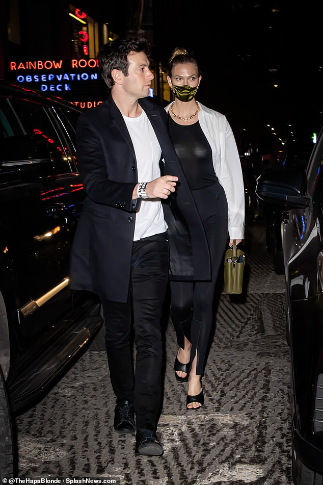 Dapper:Joshua exuded style in a slick black jacket, matching trousers, and sneakers