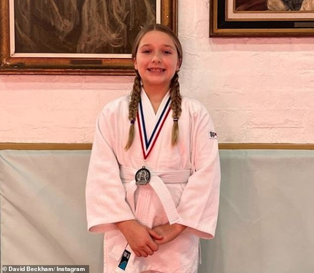 Sport talent:Harper Beckham, 10, made her dad David Beckham, 46, proud this weekend after winning a silver medal in a Judo competition