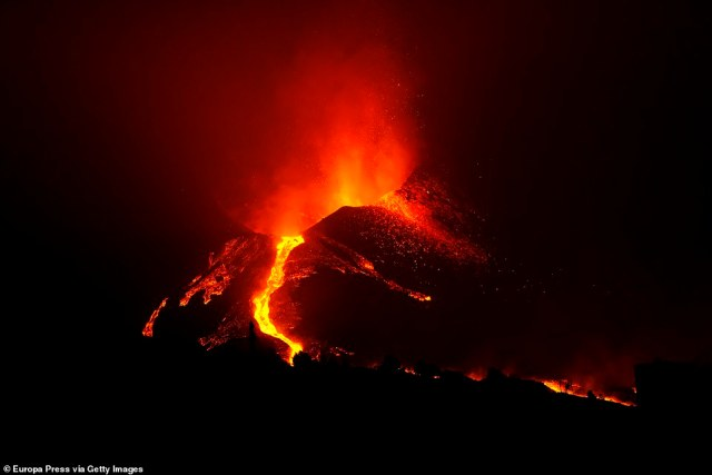Blocks of molten lava as large as three-storey buildings rolled down a hillside on the Spanish island of La Palma on Sunday while a series of tremors shook the ground three weeks after the volcano erupted. Pictured:One of the eruptive mouths of the Cumbre Vieja volcano on Sunday