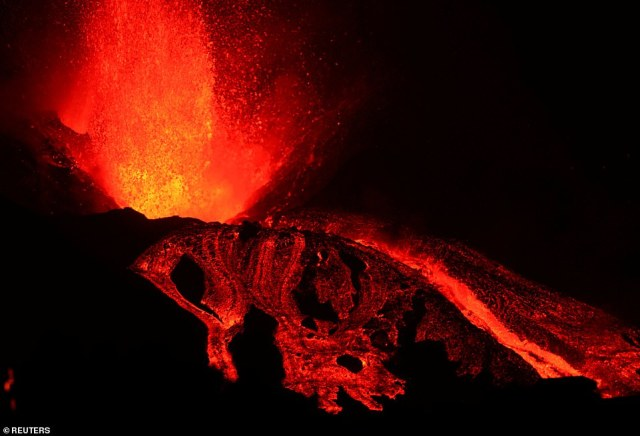 The blocks of red-hot magma flowing down the side of the volcano on Sunday were the size of three-storey buildings, the Spanish Institute of Geology and Mining said. Pictured:The Cumbre Vieja volcano continues to erupt on the Canary Island of La Palma on Sunday