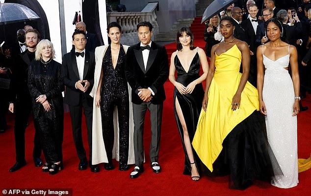 Team Bond: Finneas O'Connell, Billie Eilish, Rami Malek, screenwriter Phoebe Waller-Bridge, director Cary Joji Fukunaga, Ana de Armas, Lashana Lynch and Naomie Harris all posed on the carpet together