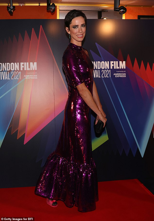 Gorgeous: Rebecca who is the director of the new release, looked stunning in the stand-out number which had three quarter length sleeves and and a ruffled hem
