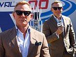 Daniel Craig looks dapper in a trendy brown suit as he attends NASCAR in North Carolina
