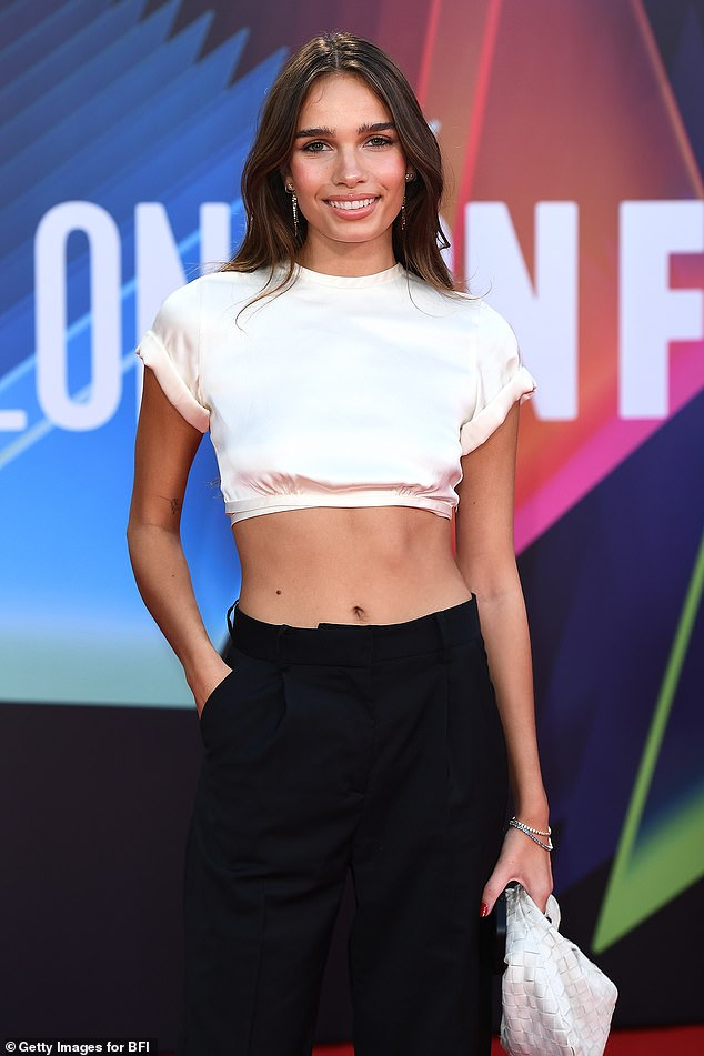 Beautiful: Hana Cross offered a glimpse of her toned abs when she attended the UK premiere of the film The French Dispatch at the London Film Festival on Sunday.