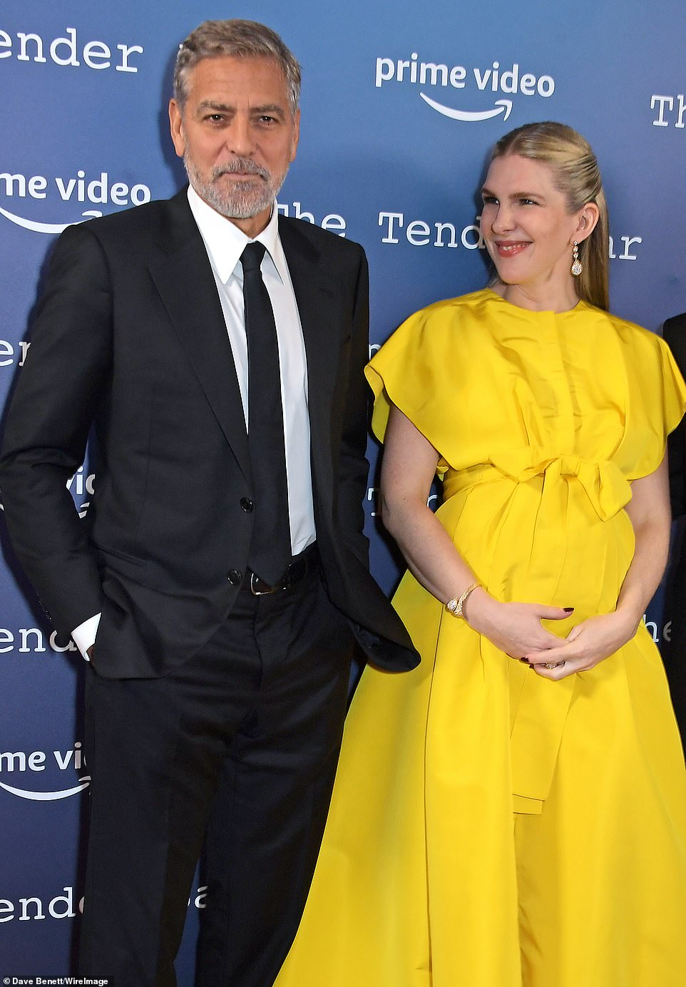 Happy:Accentuating her natural beauty with a full face of make-up, the American Horror Story cast member beamed with delight as co-star George Clooney joined her for a series of snaps