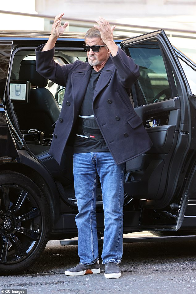 Looking good: The actor completed his laid back look with grey trainers and he donned a pair of sunglasses