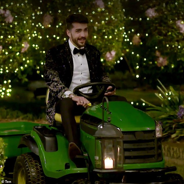 Fun guy: Darvid woos Brooke after he arrives to the red carpet riding a lawnmower. 'That's one way to rock up!' Brooke giggles, clearly surprised by his mode of transportation