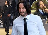 Keanu Reeves flashes a smile and takes a cigarette break on the set of John Wick: Chapter 4 in Paris