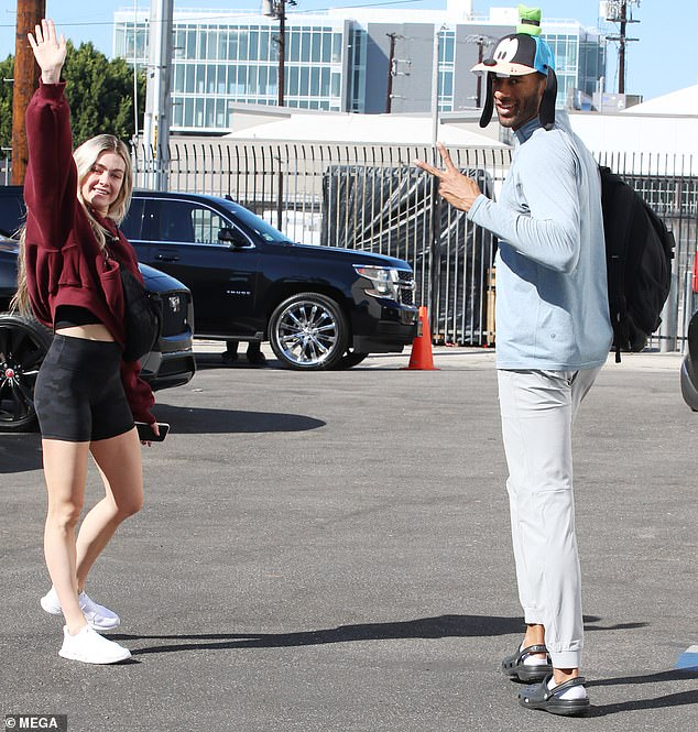 Cheerful: The former football player and his dance partner Lindsay Arnold were all smiles as they finished up their practice.