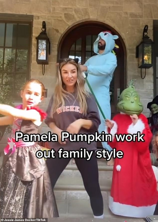 'You're welcome!'Country crooner Jessie James Decker and her family donned costumes to perform the Pamela Pumpkin Halloween Workout on the steps of their Nashville home on Sunday