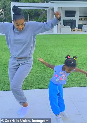 Like mother like daughter: Kaavia expertly followed Union's lead as she copied all her dance moves to the best of her ability