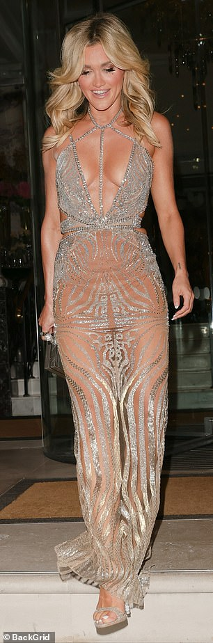 Sizzling: The Pussycat Dolls star added inches to her enviable frame with a pair of silver heels