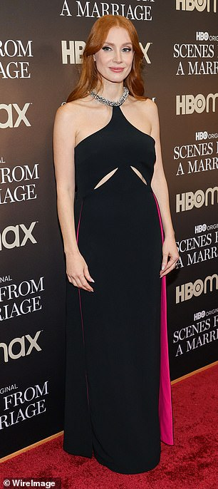 Pretty: Chastain rocked a glamorous makeup look and red hair over her shoulders