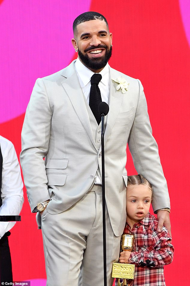 Special outtake: The Certified Loverboy artist shared a picture of himself and the youngster and captioned it, 'TEACHA. MORE LIFE KID,' using two pink heart emojis; seen at the Billboard Music Awards