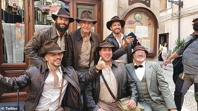 Doppelgängers: Harrison Ford appeared to be seeing double as he posed with a group of Indiana Jones fans all dressed in his iconic costume, while on the film's set in Sicily