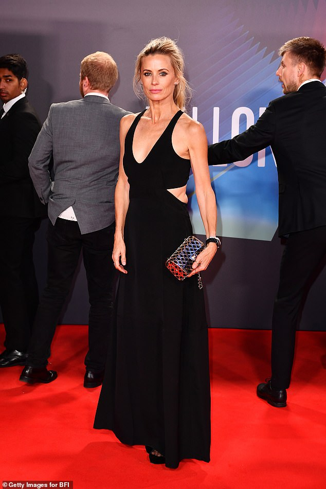 Style: She completed the ensemble with a black and silver clutch bag and added height to her frame with black heels