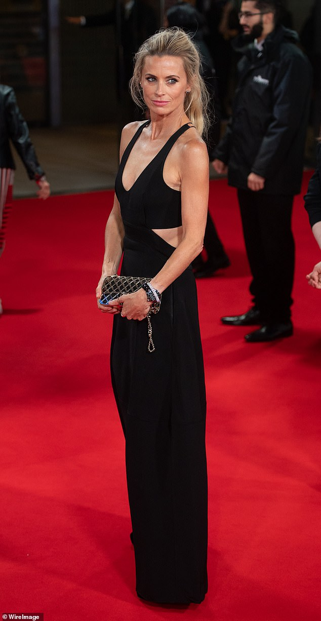 Stunning: Laura Bailey, 49, showed off elegance in a black cut-out gown for The Tender Bar premiere at the BFI London Film Festival on Sunday.