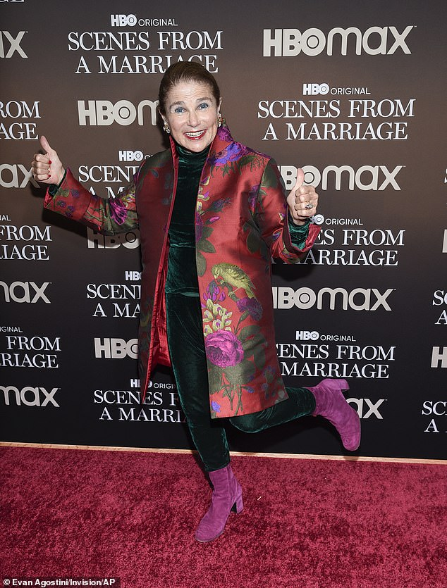Having fun:Feldshuh wore a red patterned coat and pink suede booties