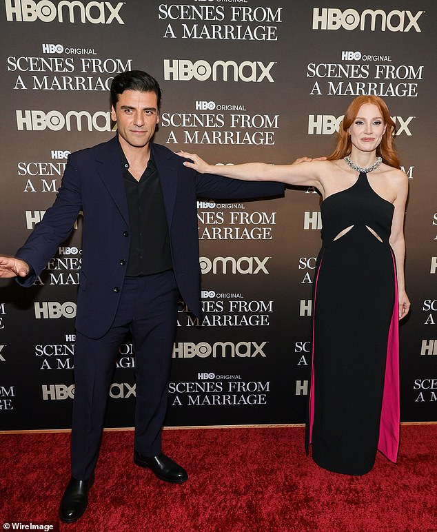 Cheeky:Upon seeing each other, Chastain smiled at him, before placing one hand on his shoulder as they stood an arms-length apart