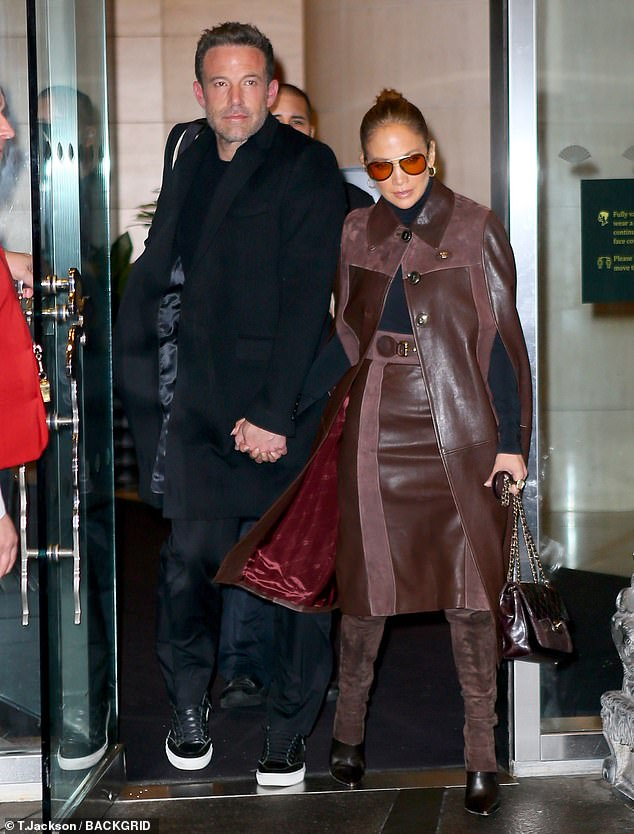 Fashion icon:She accessorized with a brown quilted Chanel handbag and amber-tinted aviator sunglasses while wearing her brunette tresses back in a ponytail
