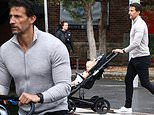 Feeling nippy, Tim? Robards shows off his bulging pecs in a skintight grey top