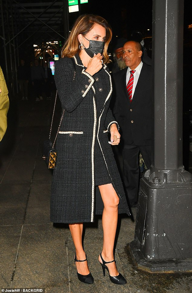 Timeless:Her nighttime look consisted of a classic black tweed mini dress that she wore with a matching overcoat