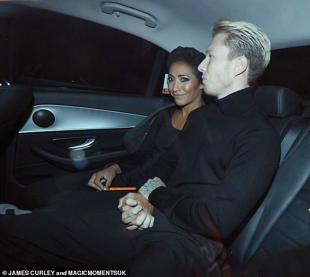 And breathe: On Sunday evening Strictly Come Dancing star Karen Hauer, 39, smiled with relief as she left the show with her beau Jordan Jones Williams
