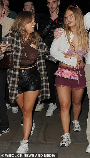 Happy days: Maisie was with her 24-year-old sister Scarlett and a group of friends