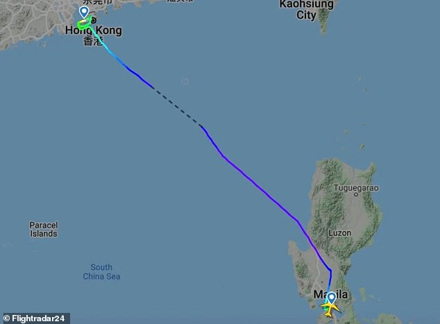 After a diversion to Manila, passengers were forced to spend the night on the plane amid Covid restrictions and eventually took off for Hong Kong again (pictured) 18 hours later