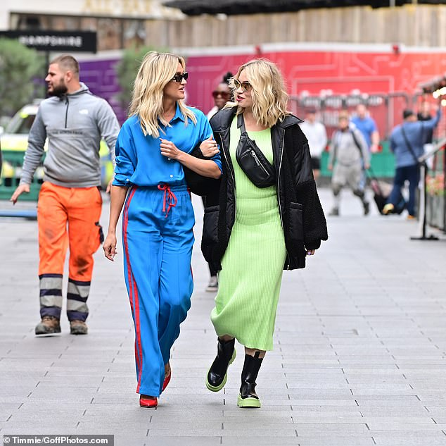 STYLISH: Ashley, 40, turned heads in full blue and stepped out wearing chic sunglasses and bright red heels, while Kimberly, 39, opted for a figure-hugging lime green dress.