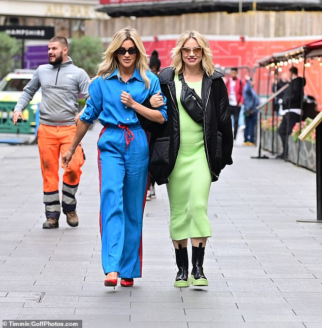 Out and about: Ashley Roberts is reunited with her Pussycat Dolls bandmate Kimberly Wyatt, with the popstar strolling hand-in-hand through London