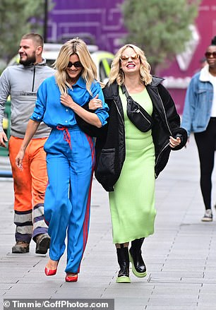On the colours: Both women wore stylish sunglasses and could barely stop smiling as they strolled the capital