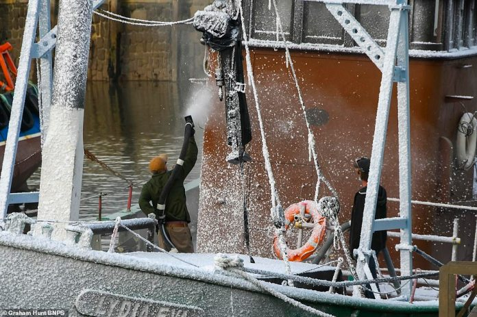 Production:The film star appeared to be shooting a winter scene as technicians were spotted spraying a boat with fake snow