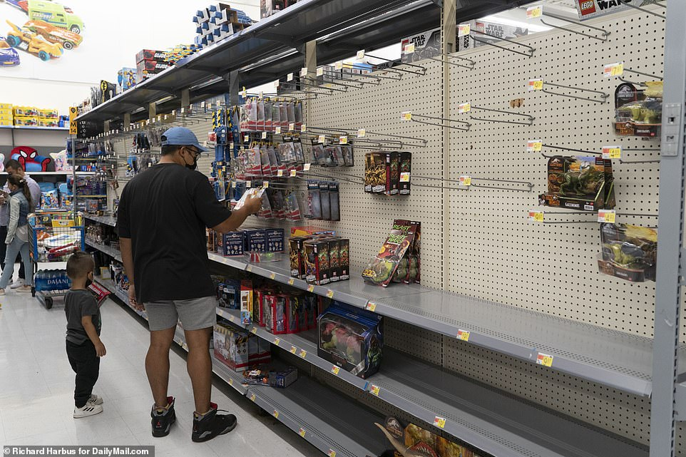CONNECTICUT: Empty shelves and racks at a Walmart in Norwalk, Connecticut, on Sunday. Customers in the store were limited to one bundle of toilet paper and one bundle of paper towel because of the shortages