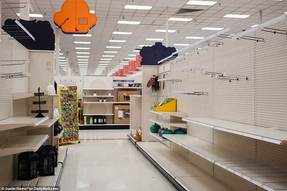TEXAS: This Target store in El Paso - which would ordinarily be stuffed with Halloween goods - was largely empty on Sunday