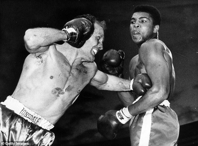 British legend Sir Henry Cooper (left) confronts Muhammad Ali at Wembley in 1963
