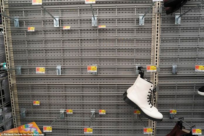 CONNECTICUT: A lonely pair of boots in the shoe section of Walmart in Norwalk, Connecticut, on Sunday where shoppers were limited to one packet of toilet paper and one of paper towels